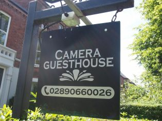 Camera Guest House Sign